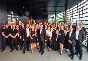 The LJ Hooker team dressed formally for their gala auction event