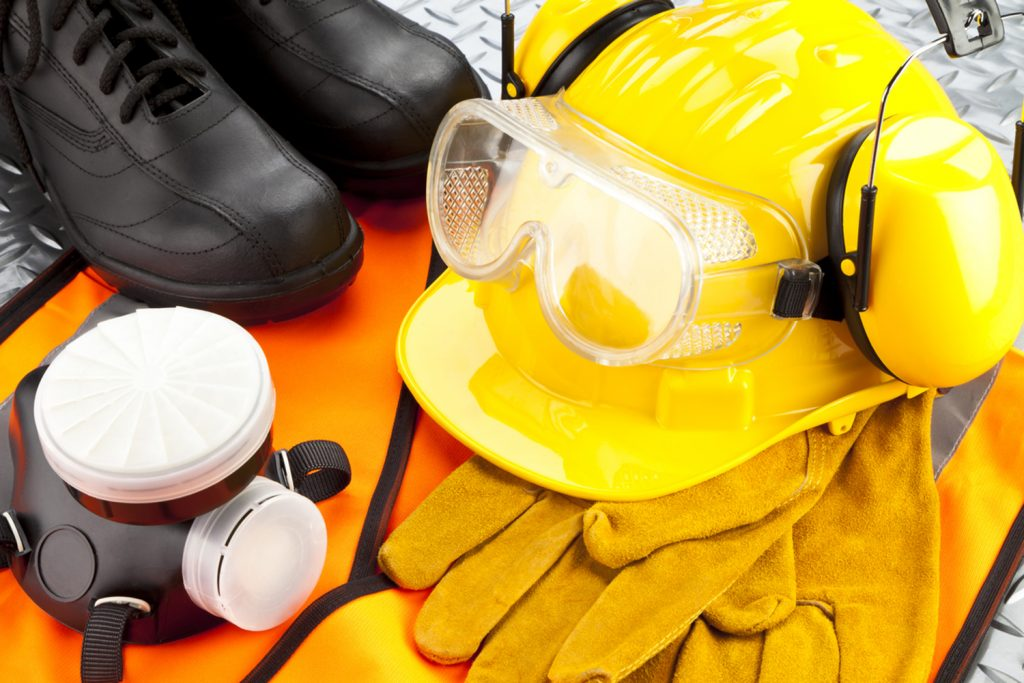 work safe gear all together with helmet, boots, mask, gloves and eyewear
