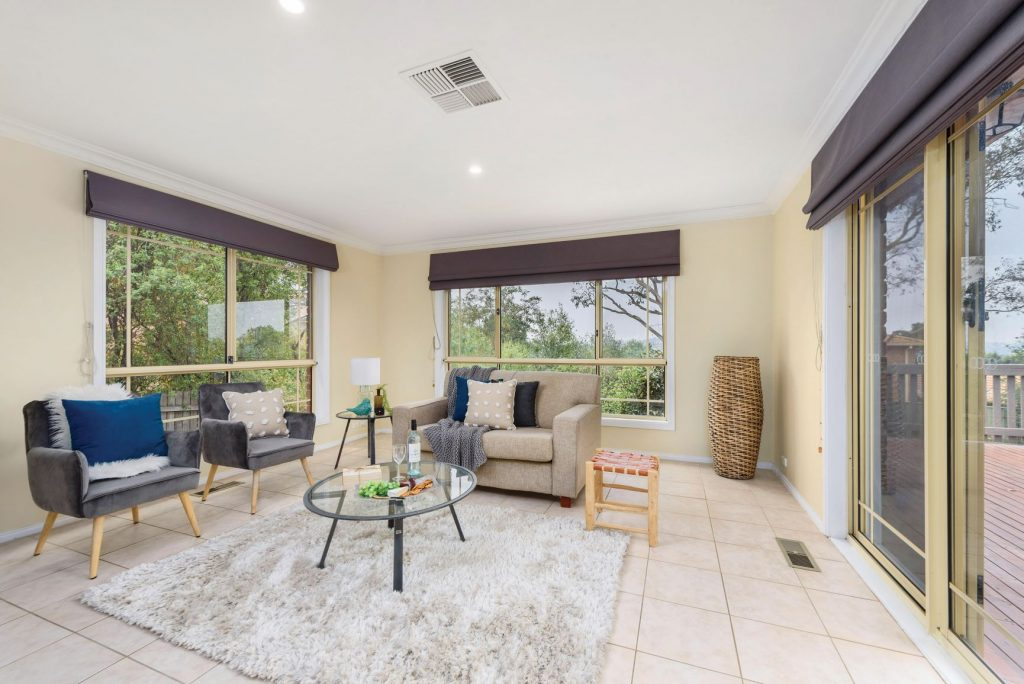 dining room with exceptional features including large windows and outdoor balcony on the right. Table and chairs in the room