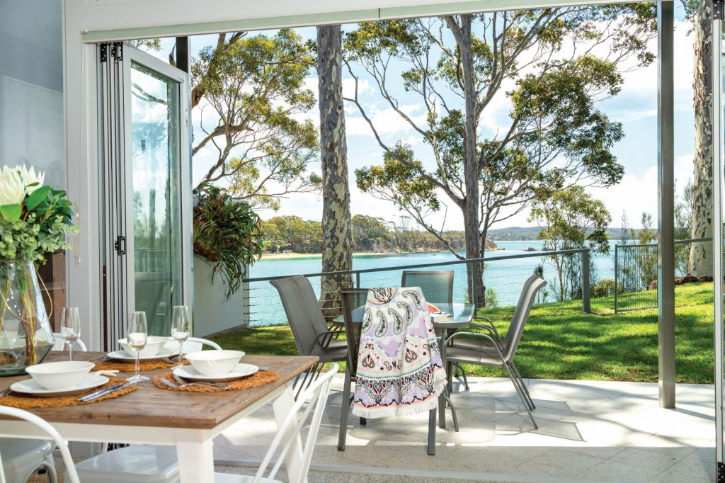 dining room with view outside of water