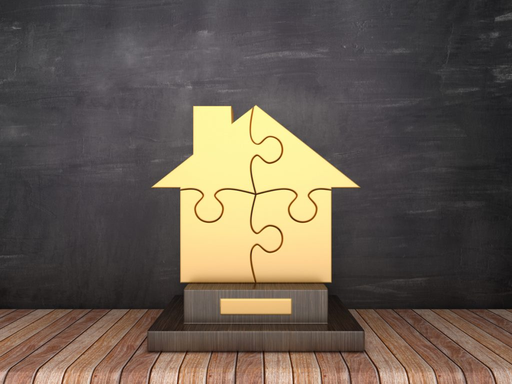 four wins for act. Trophy in the shape of a house