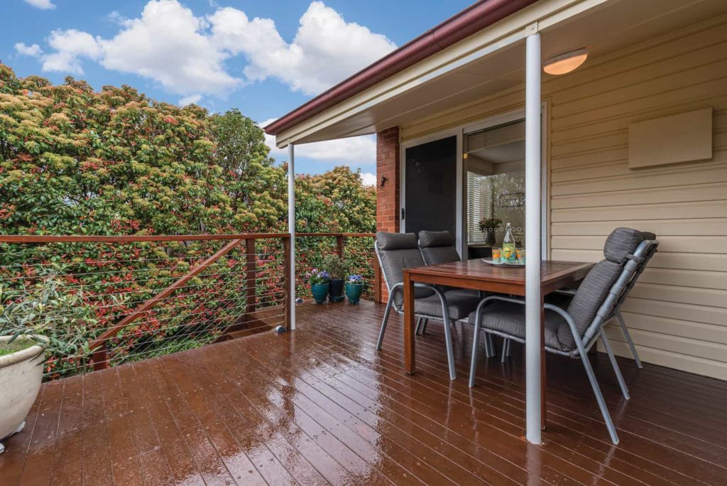 deck of home with outdoor furniture