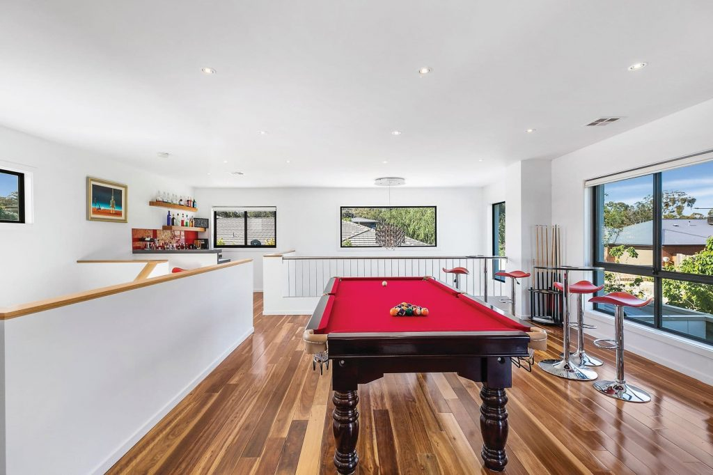rumpus room with a pool table